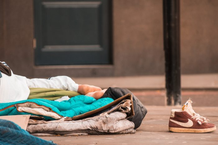 coat and sleeping area of homeless person