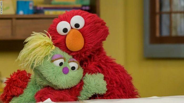 sesame street characters now adress the opioid crisis as elmo gives karli a hug