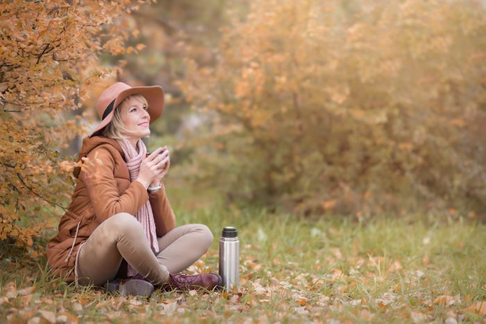 hot drink infused in hands of happy fall walker