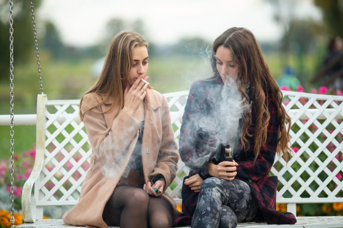 one girl weed vape using, another smoking
