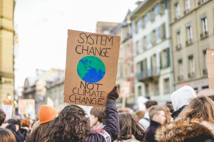 effects of climate change represented by people protesting inaction