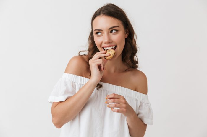 how long do edibles last represented by girl eating cookie