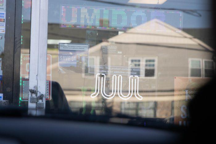 local vape store sign advertising JUUL