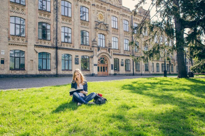 young woman on college campus studying, perhaps benefitting from Ryan's Law