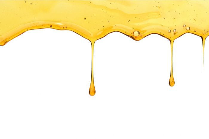 thc syrup driping down a blank background