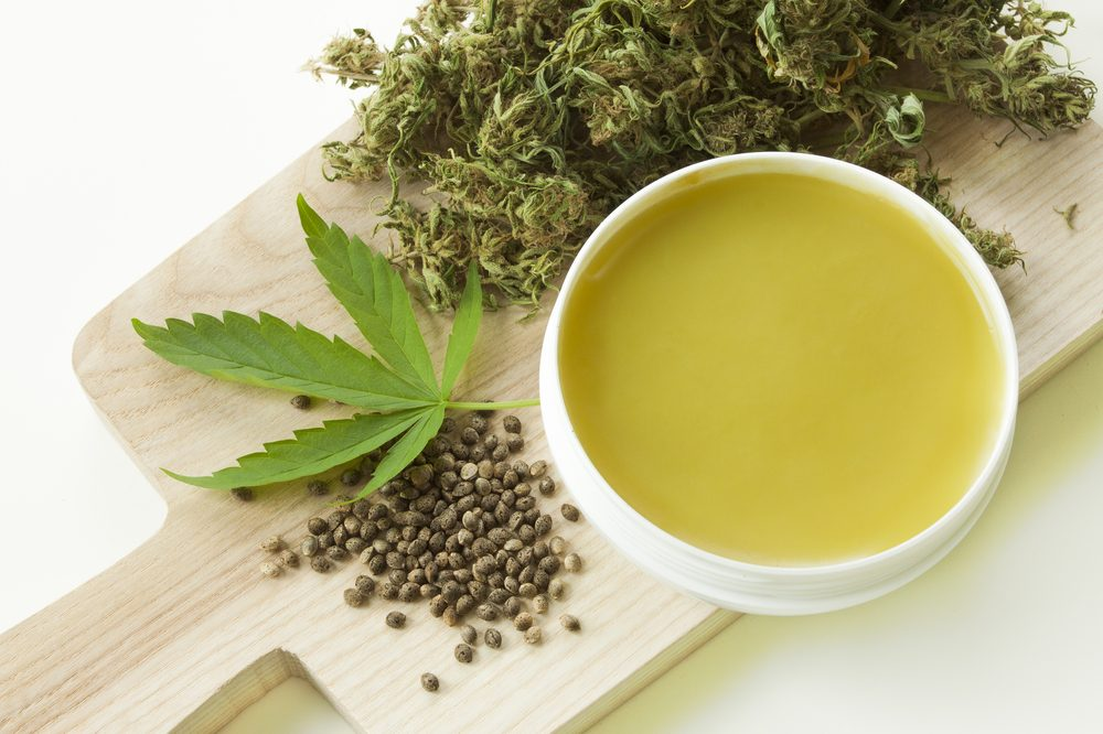 cbd salve with hemp seeds and leaf