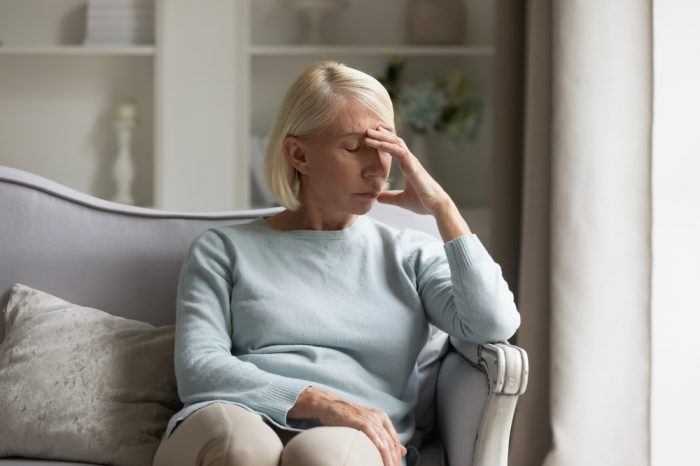 older female adult living with chronic pain