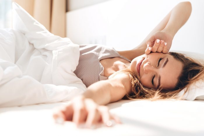 are yuo sleeping better with cannabis? This older man in bed in pyjamas is
