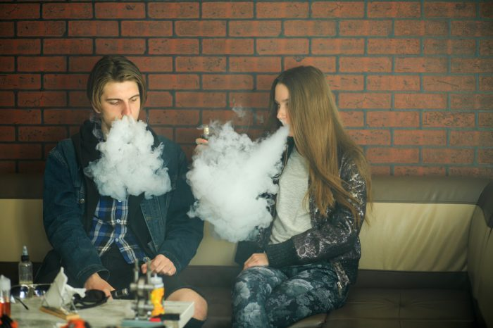 smoker friendly concept represented by young people smoking inside