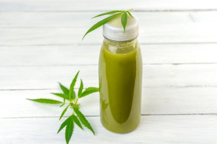 thc beverages with cannabis leaves around them