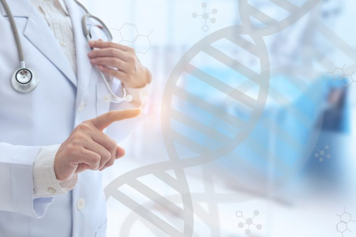 MTHFR GENE MUTATION study from a doctor looking at double helix