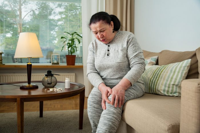 bone pain hurting older lady on couch