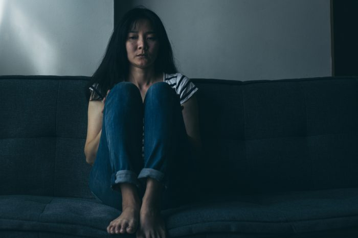 schizoprenia and cannabis use represented by sad younger woman