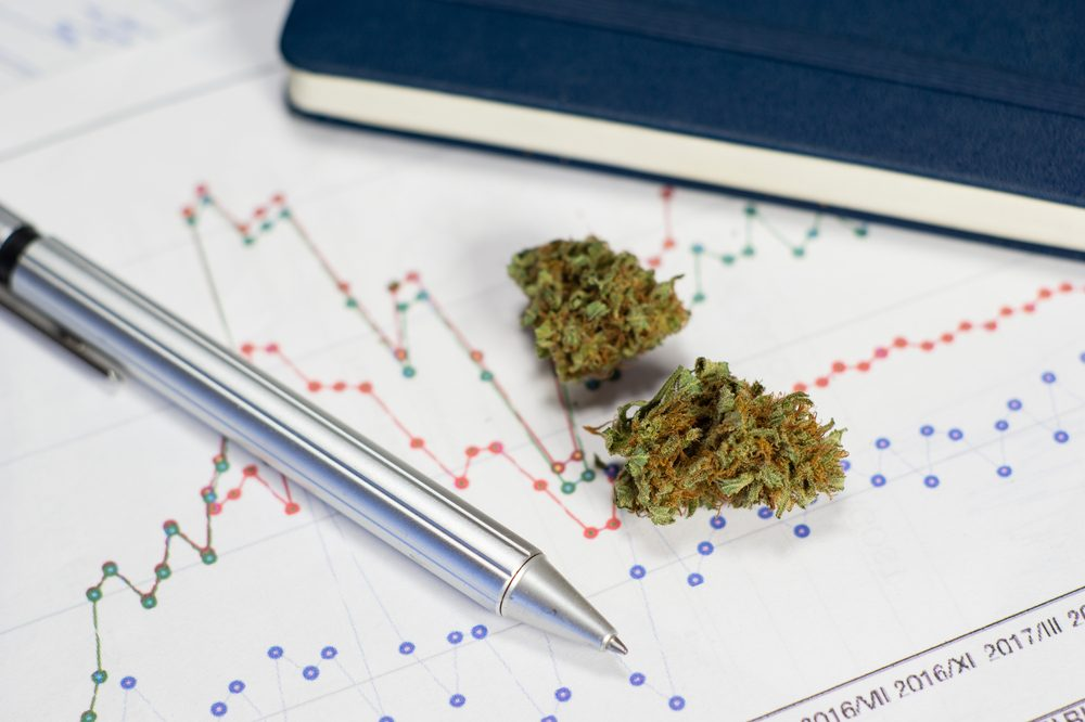 thcp could be in these cannabis buds sitting on a chart next to a pen