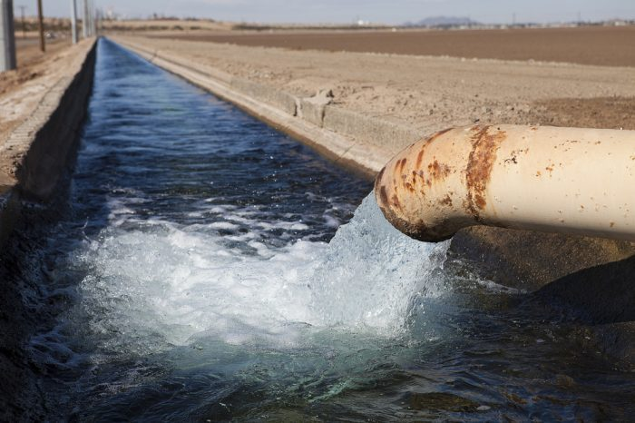 water security represented by pipe going into irrigation canal