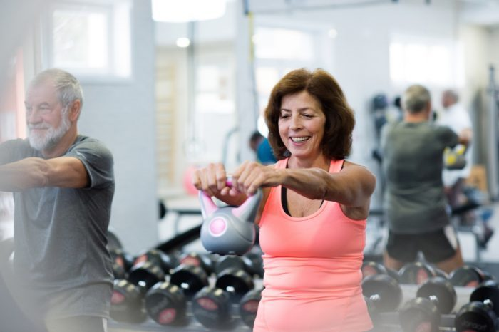 older white woman working on muscle development