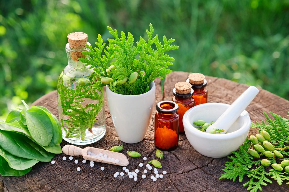 naturopathy represented by oils and plants and homemade medicine