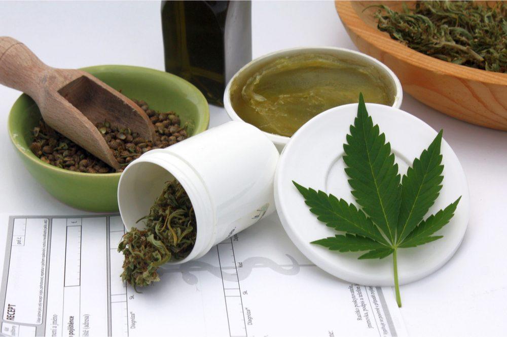 cannabis pain salve with cannabis leaf and seeds
