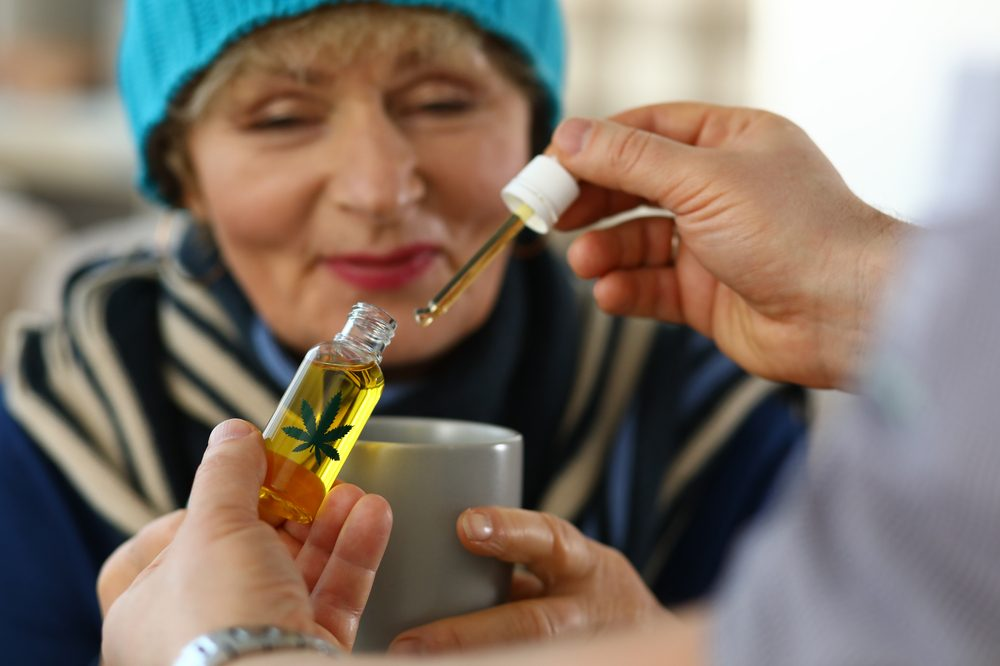 Woman receives cannabis oil, this consumption method can help when caring for patients with cardiovascular disease