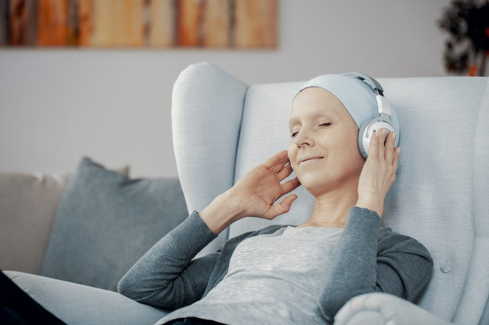 Dying at home with cannabis can make things easier for patients like this woman with cancer listening to music