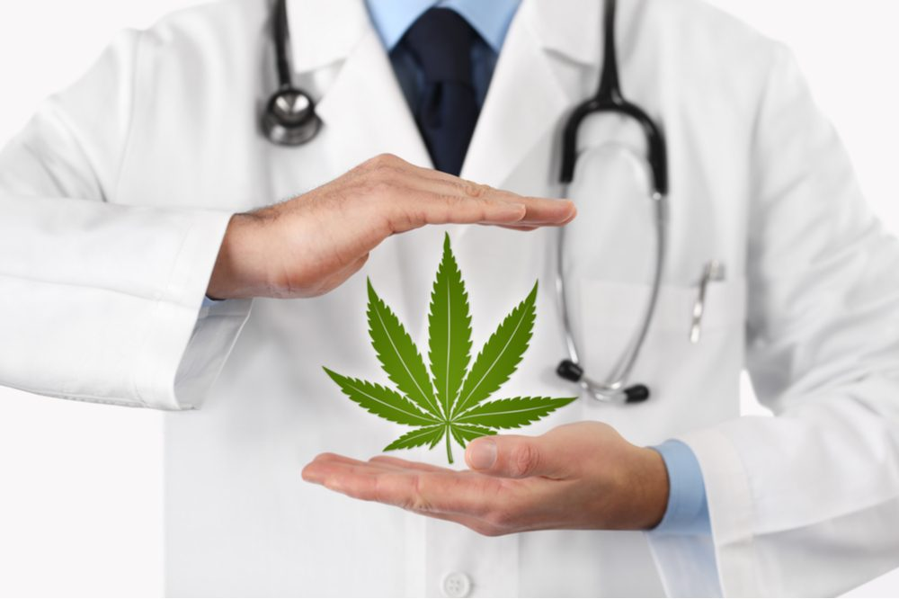 Doctor with cannabis leaf, the plant offers patients the option of dying at home