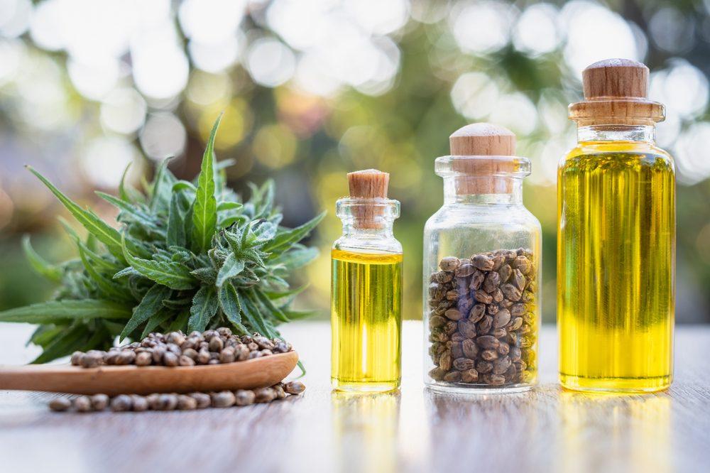 A bottle of hemp oil beside a bottle of CBD oil. Although it doesnt contain CBD hemp oil benefits are plentiful