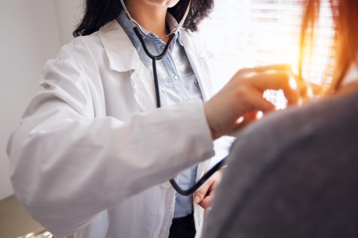 left ventricle being checked by female asian doctor in lab coat