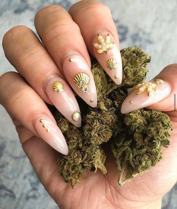 Getting a weed manicure, like these cannabis themed nails, is a popular choice at nail salons