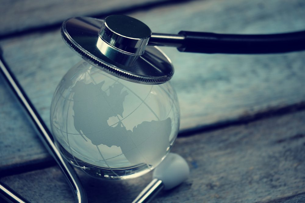 A stethoscope sits on a glass globe. World Health Day is this April 7th