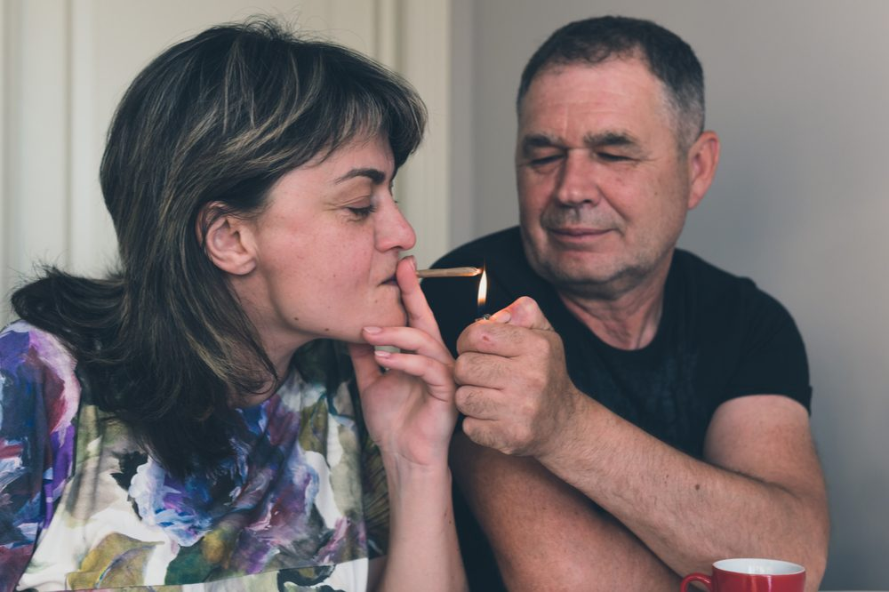 men's sexual health represented by middle aged white couple smoking together