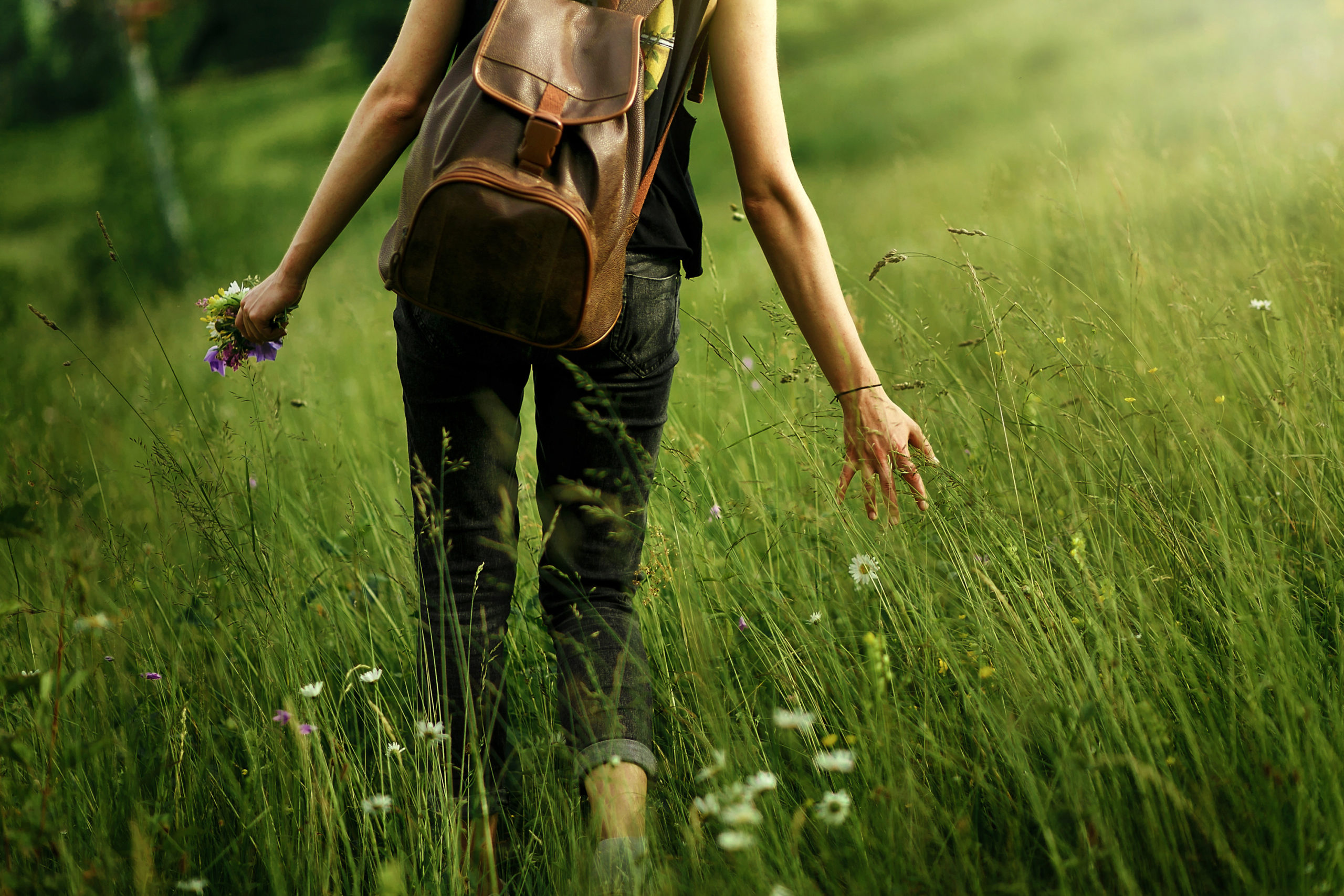 RxLeaf Naturals category represented by woman walking in field of grass