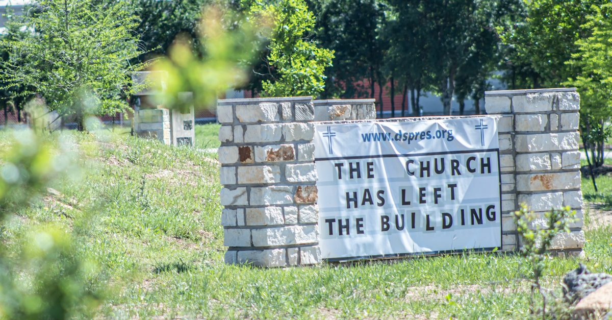 image of church wall that says: the church has left the building
