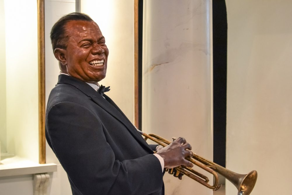 social inequality represented through the music of Louis Armstrong and this wax statue of his younger years