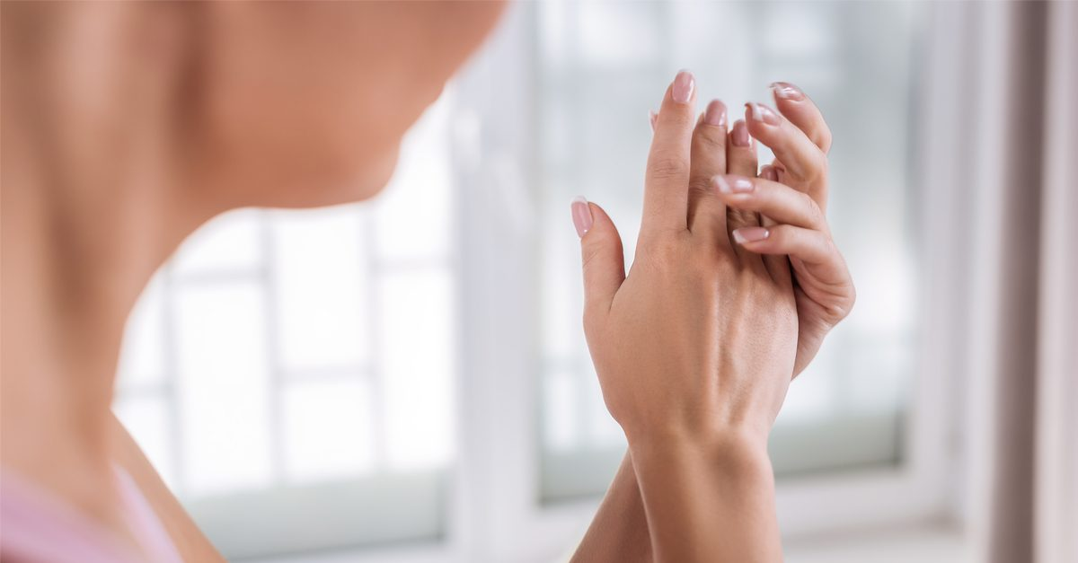 sugar scrub on white woman's hands