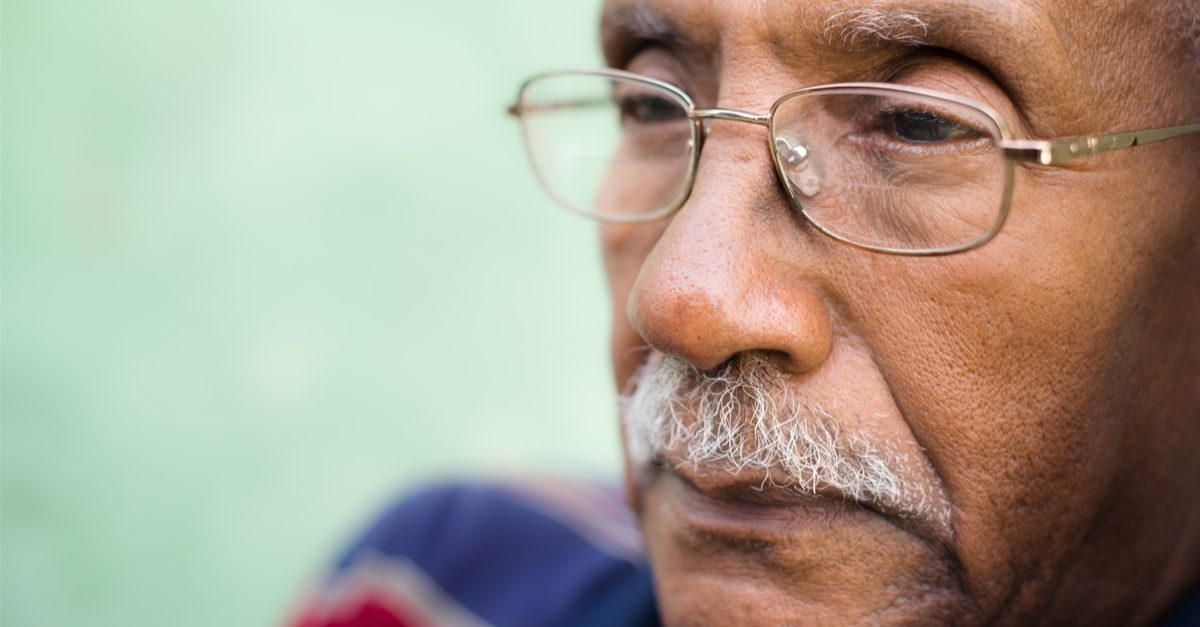 Systemic discrimination represented by elderly black man who may have faced it.