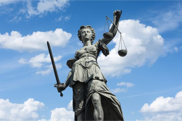 systemic racism represented by justice statue