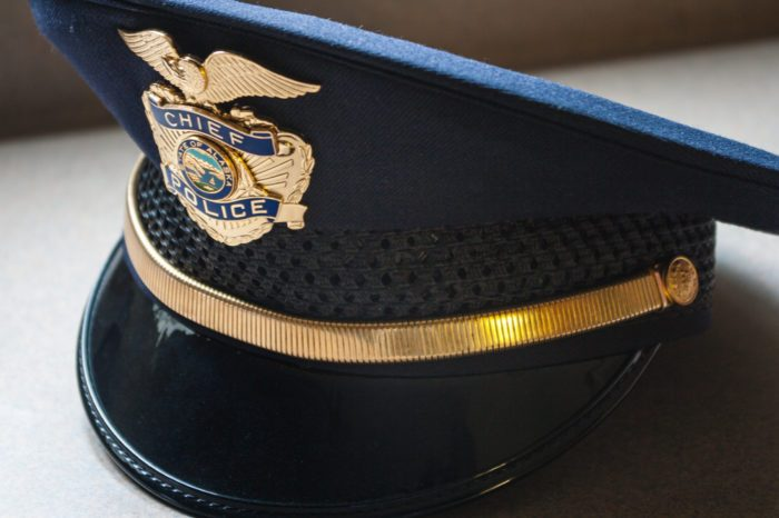 Decriminalization of Drugs represented by police chief's hat