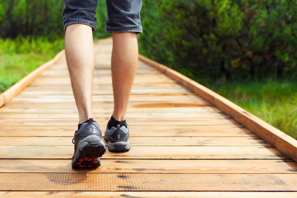 mindfulness therapy represented by shot of legs walking in forest