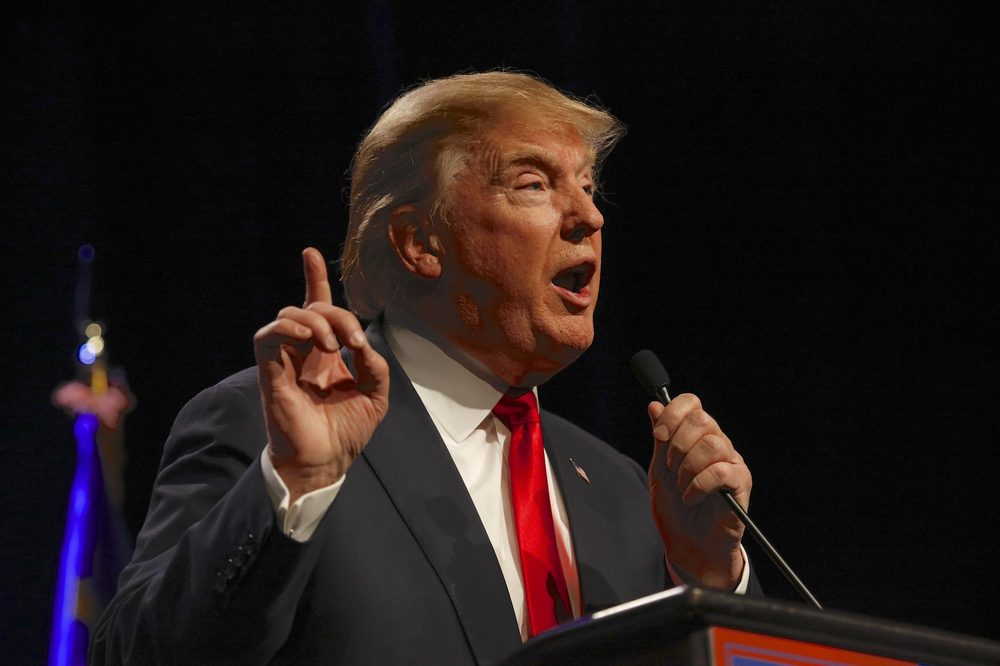 trump speaking perhaps on cannabis, gesturing upwards