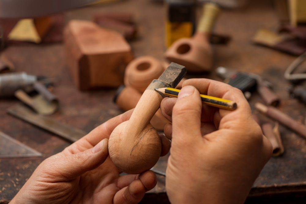 wooden weed pipe being carved