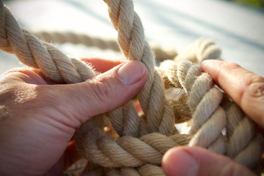 natural pet toys represented by white person tying rope