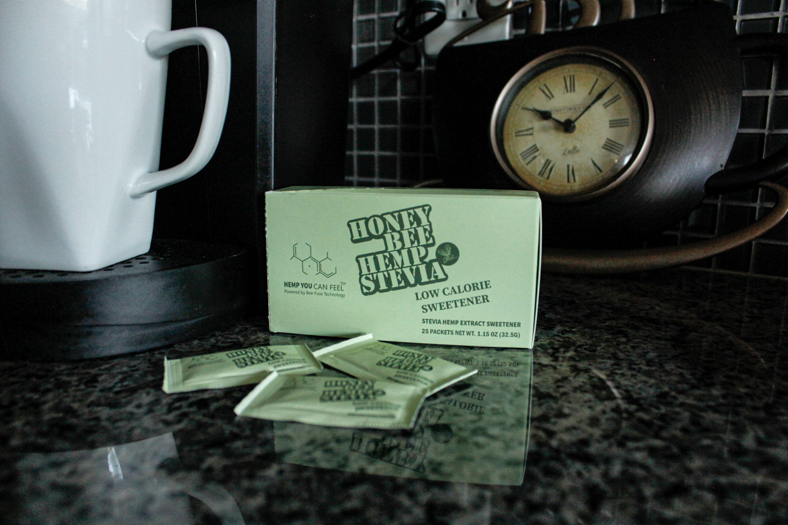 stevia packets and box sitting on kitchen counter beside coffee cup