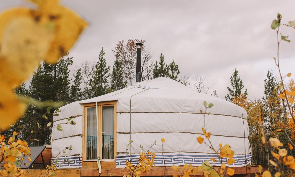 living off grid represented by a yurt in the woods