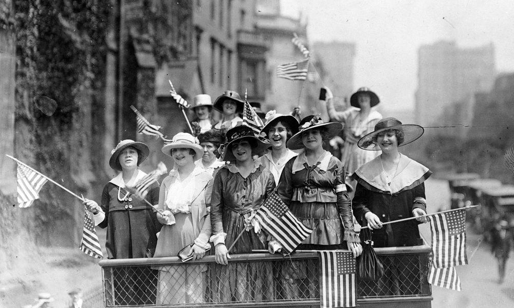 big pharma represented by American women of 1900s waving flags