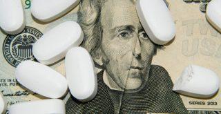 big pharma medicine represented by twenty dollar bill with pills on it