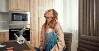 young woman smoking bong